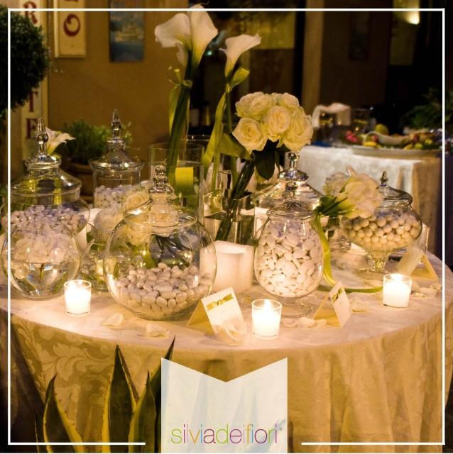 Allestimenti floreali per un matrimonio quanto spendere for Addobbi tavoli matrimonio con candele